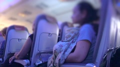 Bluured mom breastfeeding baby on flight Stock Footage