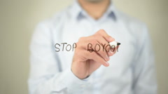 Stop Boycott , man writing on transparent screen Stock Footage