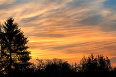 sunset with orange sky and clouds - stock photo