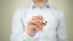 Stop Sanctions , man writing on transparent screen Stock Footage