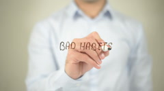 Bad Habits  , man writing on transparent screen - stock footage