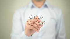 Child Soldiers, man writing on transparent screen Stock Footage