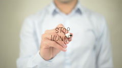 Stop Hunger , man writing on transparent screen - stock footage