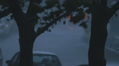 Car goes away on windy rainy dark evening horor scene Stock Footage