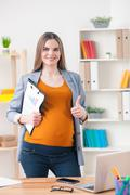 Cute expectant businesswoman is showing ok sign Stock Photos