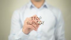 Stop Slavery , man writing on transparent screen Stock Footage