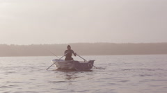 Man rowing on a calm lake Stock Footage