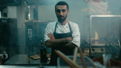 HD cinemagraph. Handsome Caucasian chef standing in the restaurant kitchen Stock Footage