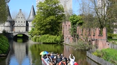 Rabot and tourists in boat during sightseeing tour in Ghent, Belgium Stock Footage