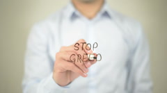 Stop Greed , man writing on transparent screen Stock Footage