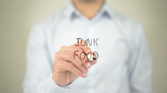 Junk Food , man writing on transparent screen - stock footage