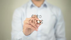 Euro Crisis , man writing on transparent screen Stock Footage