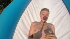 4K. Bold Man Sliding in Extreme Water Slide in Water Park. Stock Footage