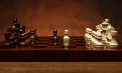 chess game with pieces on the table - stock photo