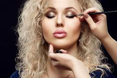 Beautiful woman with bright eye makeup, sexy makeup with black eyeliner. Arrow Stock Photos