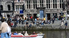 Tourists sunning along the Graslei at Ghent, Flanders, Belgium Stock Footage