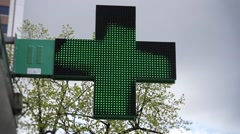 Illuminated Pharmacy Sign Green Cross Animated Stock Footage