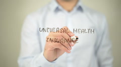 Universal Health Insurance , man writing on transparent screen Stock Footage