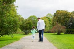 happy family walking in summer park - stock photo