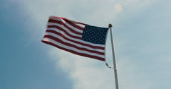 USA American flag unfurling in the wind Stock Footage