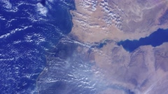 Shot from space to the earth with sea and a continent - stock footage