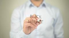 Black Market , man writing on transparent screen - stock footage