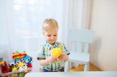 happy little baby boy with ball clay at home - stock photo
