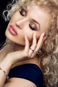 Style, fashion, manicure, cosmetics and make up. Beautiful plump lips makeup and Stock Photos