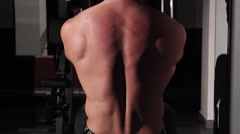 Athletic man working out at the gym, shoulders  - stock footage
