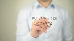 Investing For Beginners , man writing on transparent screen Stock Footage
