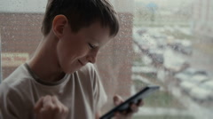 Child playing with mobile phone. Stock Footage