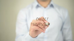 Credit Management , man writing on transparent screen Stock Footage