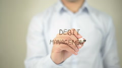 Debt Management, man writing on transparent screen - stock footage