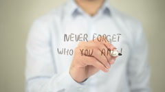 Never Forget Who You Are , man writing on transparent screen Stock Footage