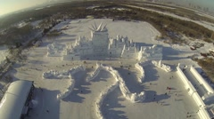 AERIAL FLY OVER OF GIANT SNOW AND ICE SCULPTURE IN HARBIN CHINA (2of4) - stock footage