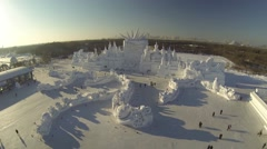 AERIAL FLY OVER OF GIANT SNOW AND ICE SCULPTURE IN HARBIN CHINA (3of4) - stock footage
