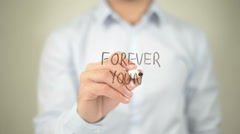 Forever Young , man writing on transparent screen - stock footage