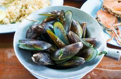 Asian green mussel Steam with Sweet Basil Stock Photos