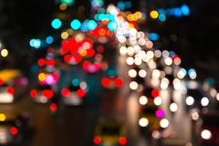 abstact blur bokeh of Evening traffic jam on road in city - stock photo