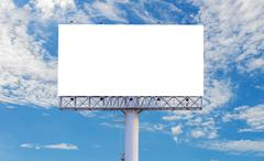 Blank billboard ready for new advertisement with blue sky background Stock Photos