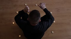 Witch man in candle circle making spiritual ritual - slow motion - stock footage