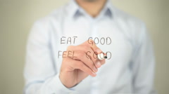 Eat Good Feel Good , man writing on transparent screen Stock Footage
