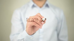 Reach Out , man writing on transparent screen Stock Footage