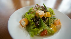 Fresh salad with fish Stock Footage