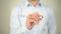 Hall Of Fame, man writing on transparent screen Stock Footage