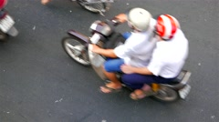 Ho Chi Minh City - Close up aerial street view with motorbikes passing by. Stock Footage