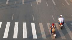 Ho Chi Minh City - Close up aerial street view with motorbikes and crosswalk Stock Footage