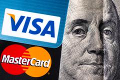 Visa and MasterCard with Benjamin Franklin portrait Stock Photos