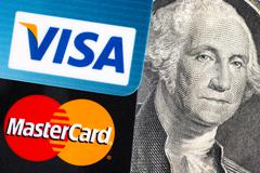 Visa and MasterCard and dollar bill with George Washington portrait Stock Photos