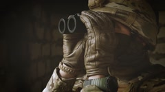 The soldier his equipment looking through binoculars. Close-up Stock Footage